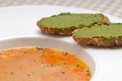 Italian minestrone soup with pesto crostini on side Royalty Free Stock Photography
