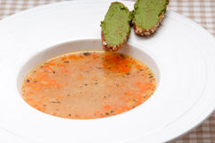 Italian minestrone soup with pesto crostini on side Royalty Free Stock Photos