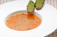 Italian minestrone soup with pesto crostini on side Royalty Free Stock Photos