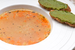 Italian minestrone soup with pesto crostini on side Stock Photography