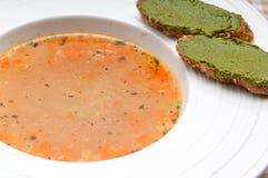 Italian minestrone soup with pesto crostini on side Stock Photography