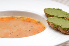 Italian minestrone soup with pesto crostini on side Stock Photo