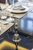 Italian Modern Model House : Silver Bell on the Dinning Table Royalty Free Stock Images