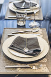 Italian Modern Model House : White Plate and Blue Napkin with Silver Spoon and Fork Dinning Set Royalty Free Stock Photography