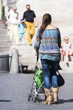Italian mother and baby in a pram Stock Photography