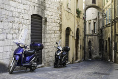 Italian motor scooter. In typical italian village Stock Photos