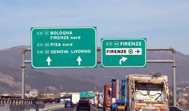 Italian motorway with many indications to main cities. Such as Bologna, Florence, Pisa or Genoa stock photography