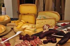 Italian mountain cheese and salami. Royalty Free Stock Photos