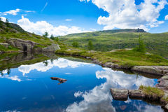 Free Italian Mountain Panorama, Clouds Reflected On Alpine Lake Stock Images - 77772874