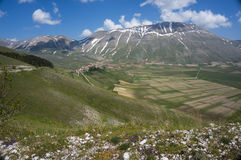 Italian mountain village Castelluccio. Beautiful view of the old italian mountain village Castelluccio, picturesque Apennine landscape, Norcia, Italy Royalty Free Stock Photography