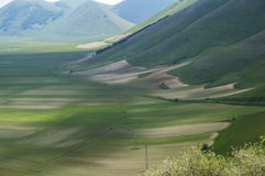 Italian mountain village Castelluccio. Beautiful view of the old italian mountain village Castelluccio, picturesque Apennine landscape, Norcia, Italy Stock Image