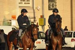 Italian mounted municipal policemen. Two Italian mounted policemen on their horses near Piazza San Pietro in Rome stock image