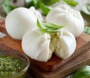 Italian mozzarella cheese stuffed with ricotta and persto. Close up Stock Photo