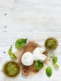 Italian mozzarella cheese stuffed with ricotta and persto. Close up Stock Image