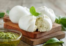 Italian mozzarella cheese stuffed with ricotta and persto. Close up Royalty Free Stock Images