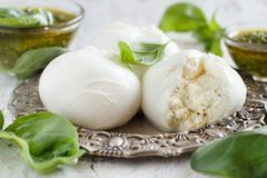 Italian mozzarella cheese stuffed with ricotta and persto. Close up Stock Photography