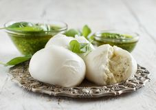 Italian mozzarella cheese stuffed with ricotta and persto. Close up Royalty Free Stock Photos