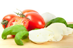 Italian mozzarella cheese with tomatoes and basil Royalty Free Stock Photography