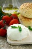 Italian  mozzarella cheese tomatoes olive oil. And bread still life Royalty Free Stock Image