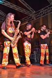 Italian musical band Antani Project playing wind instruments during the free concert on the Lecco downtown summer stage. stock photo