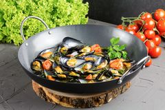 Tasty mussels from Taranto on a pan royalty free stock photography