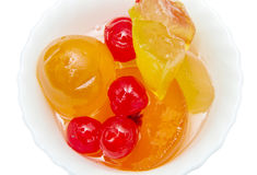 Italian Mustard with candied fruit and syrup on white bowl Stock Photos