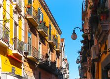 Italian narrow street with colorful houses and blue sky. Vietri sul Mare, Italy royalty free stock photo