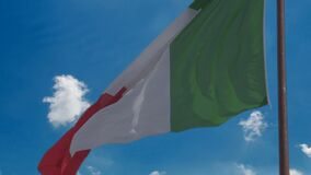 Italian national flag against blue sky background, tricolour symbol of country. Stock footage stock video