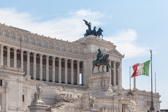 Italian national flag in front of Monumento nazionale a Vittorio Stock Images