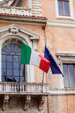 Italian national flag of Italy and European Union flag. Balcony; building; celebration; country; eu; european; facade; flag; identification; italian; italy Royalty Free Stock Photography