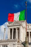 Italian nationalism and sovereignty. Nationalism and sovereignty in Italy. `Tricolore` Italian national flag fluttering in the wind before Altar of Nation royalty free stock photos