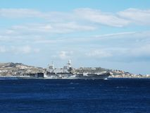 Italian navy aircraft carrier Cavour. Italian navy aircraft carrier Carvour passing through the Strait of Messina Royalty Free Stock Photo