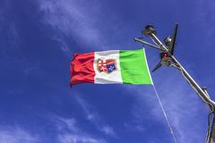 Italian Navy flag. Italian Merchant Marine flag inflated by the wind stock photography