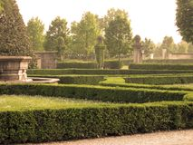 Italian neoclassic garden. With a stone fountain Royalty Free Stock Image