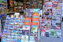 Italian newspapers, Italy. Newspaper stand in Florence, Italy. Outside a newspaper and magazines kiosk with international and national press Royalty Free Stock Image