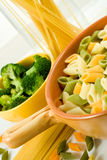 Italian noodles in bowl and spaghetti Stock Photo