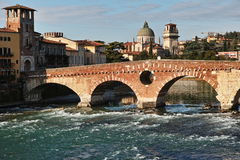 Roman bridge Ponte Pietra and church San Giorgio Royalty Free Stock Images