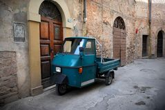 Italian old car, Umbria. Italian vintage three wheels car in a typical stone village of Italy Stock Photo