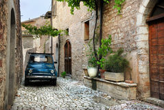 Italian old car, Umbria. Italian vintage car in a typical stone village of Italy Stock Images