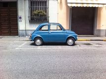 Italian old car. Vintage blue car in the street Royalty Free Stock Photo