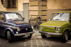 Italian Old cars. Two Fiat Old cars in Florence italy royalty free stock images