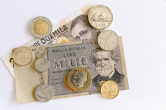 Italian old coin and a banknote Royalty Free Stock Images