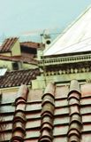 Italian roof. Italian old roof of red-brown tiles in the cloudy day Stock Photography