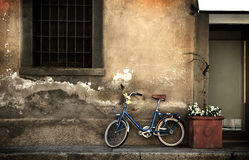 Italian old style bicycle. An italian old style small bike leaning against a grungy wall Stock Photos