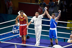 Italian Olympic Boxer Wins Gold. Roberto Cammarelle of Italy defeats Zhilei ZHANG of China to win the gold in the Men's Super Heavyweight boxing (+91kg/201 lbs) Stock Photography