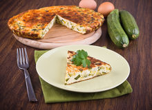 Italian omelette with zucchini. Stock Photos