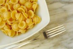 Italian orecchiette. Italian traditional orecchiette on a dish Stock Image
