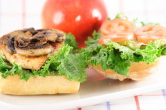 Italian organic sandwich. Fresh healthy organic chicken breast grilled to perfection with mushrooms Royalty Free Stock Images