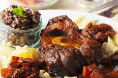 Italian osso bucco. With pasta Royalty Free Stock Photography