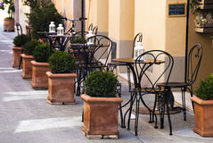 Italian outdoor cafe. Tables on a old outdoor cafe in a traditional tuscany street - Italy Stock Images